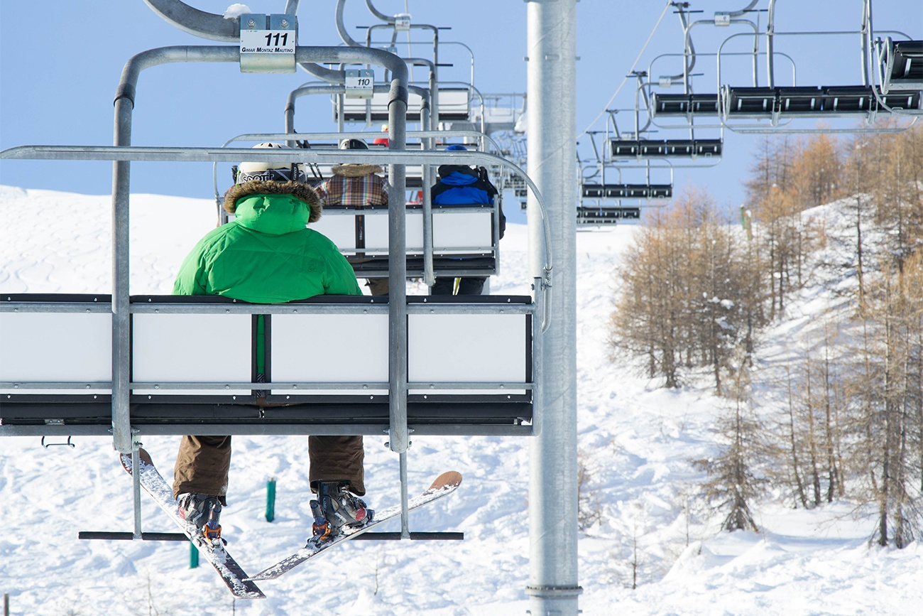 Free image: Skier on a chairlift